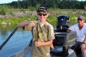 boy holding smallmouth bass